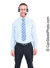 Smiling businessman standing with headset