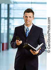 Smiling businessman - Happy businessman smiling at office...