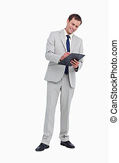 Smiling businessman taking notes
