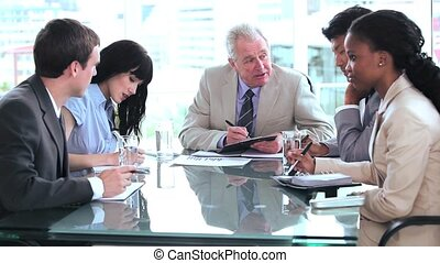 Smiling businessman talking with his team