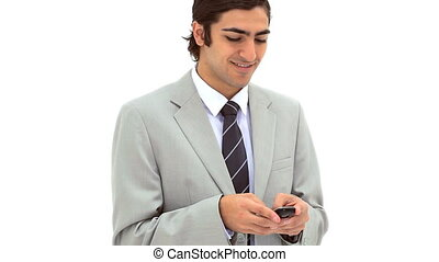 Smiling businessman texting on his mobile phone