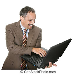 Smiling businessman using a laptop