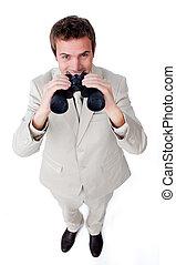 Smiling businessman using a pair of binoculars