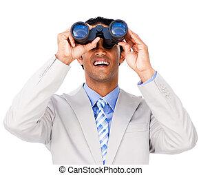 Smiling businessman using binoculars