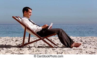 Smiling businessman using tablet