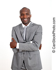 Smiling businessman with arms crossed on white backgound