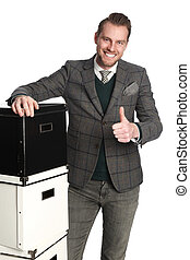 Smiling businessman with boxes