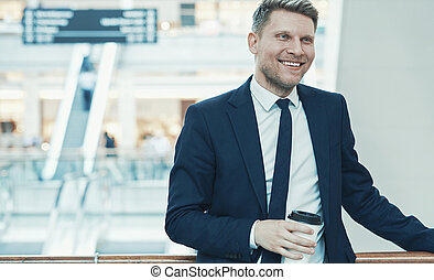Smiling businessman with coffee