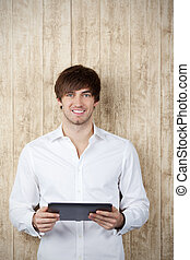 Smiling Businessman With Digital Tablet