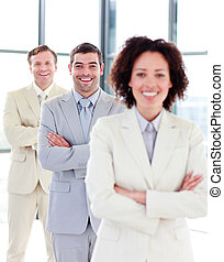 Smiling businessman with folded arms in a row