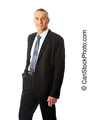 Smiling businessman with hand in pocket