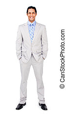 Smiling businessman with hands in pockets