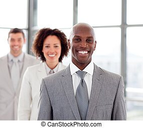 Smiling businessman with his team