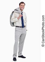 Smiling businessman with jacket over his shoulder