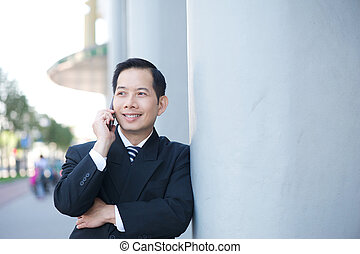 Smiling businessman with mobile phone