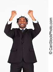 Smiling businessman with raised arms