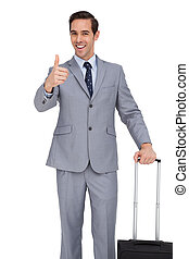 Smiling businessman with suitcase showing his thumb up