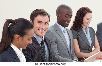 Smiling businessman working in a meeting