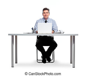 Smiling businessman working with laptop.