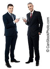 Smiling businessmen using cellphone
