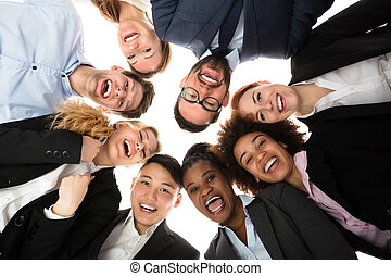 Smiling Businesspeople Standing Against White Background -...