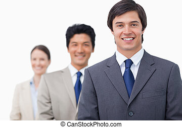 Smiling businesspeople standing in a line