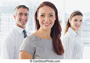 Smiling businesswoman and her co-workers