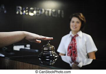 smiling businesswoman at the reception desk working