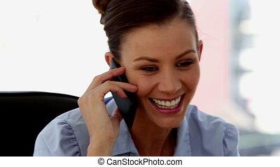 Smiling businesswoman calling