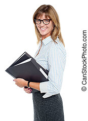 Smiling businesswoman carrying important files