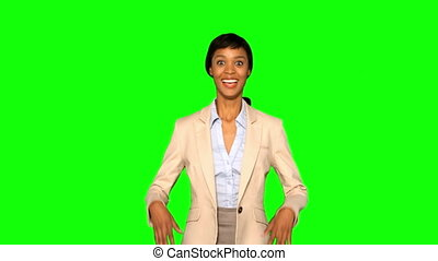 Smiling businesswoman cheering