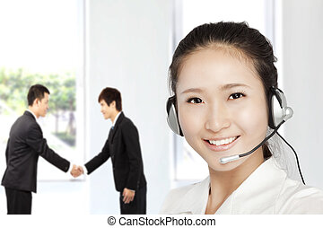 Smiling businesswoman  customer service on the phone
