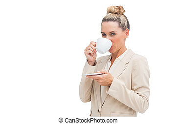 Smiling businesswoman drinking a cup