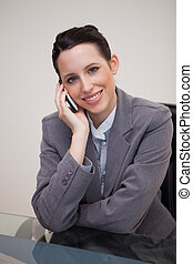 Smiling businesswoman having a call on her cellphone