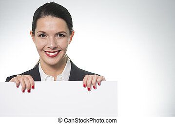 Smiling businesswoman holding a blank board