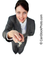 Smiling businesswoman holding a key
