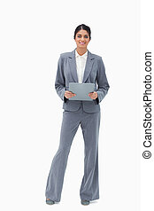 Smiling businesswoman holding clipboard