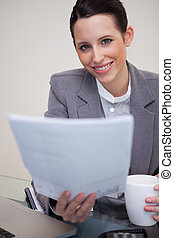 Smiling businesswoman holding contract