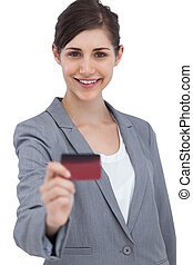Smiling businesswoman holding credit card