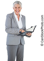 Smiling businesswoman holding her diary