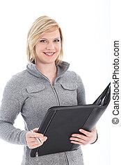 Smiling businesswoman holding large folder