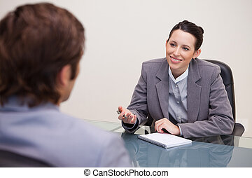 Smiling businesswoman in a negotiation