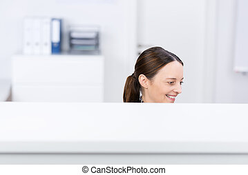 Smiling Businesswoman In Cubicle