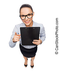 smiling businesswoman in eyeglasses with clipboard