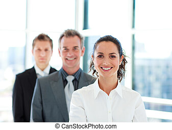 Smiling businesswoman in front of her team