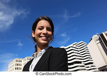 Smiling businesswoman in the city