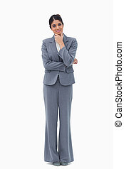 Smiling businesswoman in thoughts