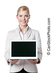 Smiling businesswoman offers computer product