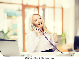 smiling businesswoman or student calling on phone