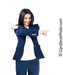 Smiling businesswoman pointing both sides